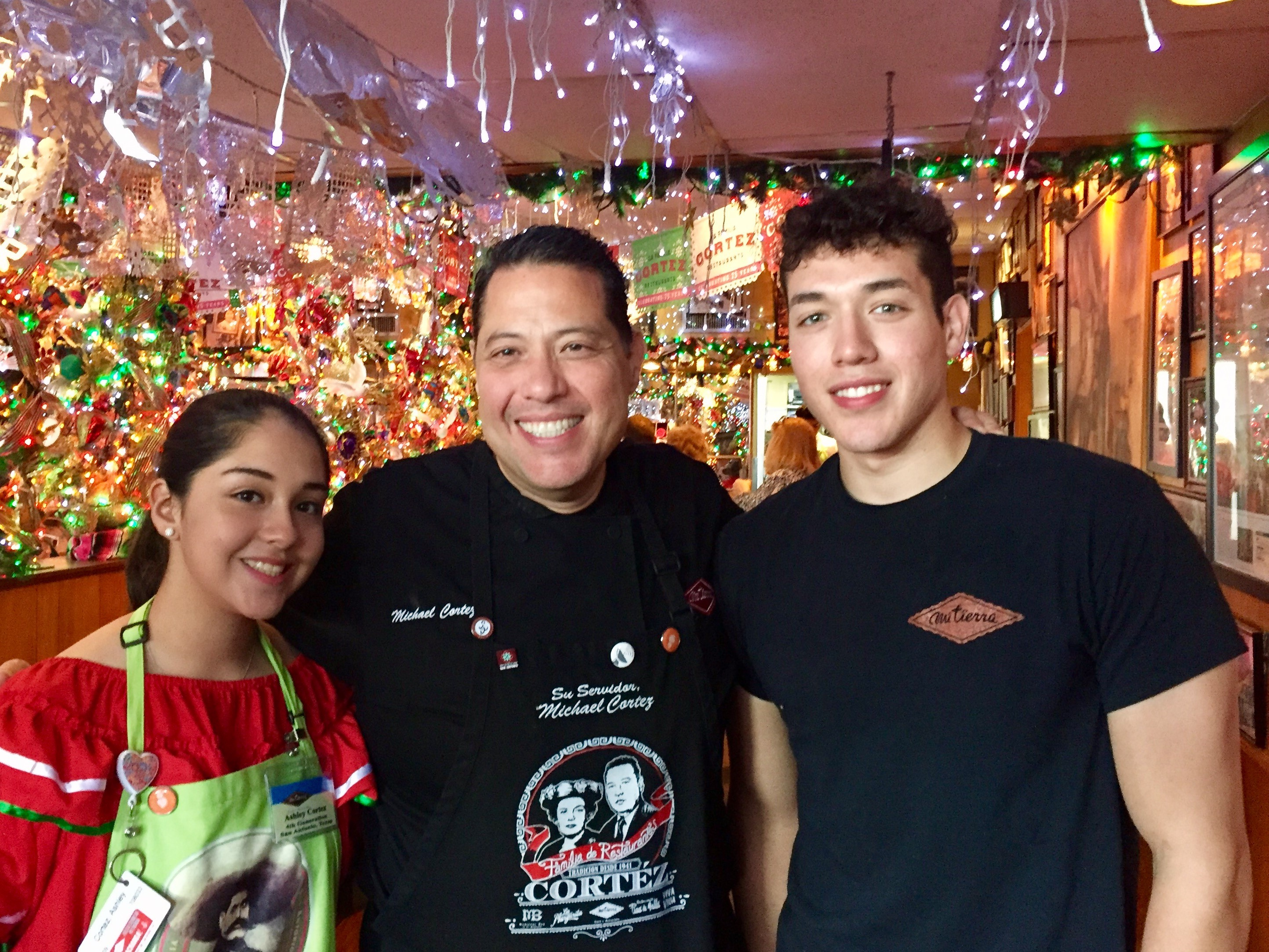 Michael Cortez, center, with daughter Ashley and son Elijah.
